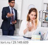 Купить «Frustrated business woman with angry chief», фото № 29149609, снято 1 июня 2017 г. (c) Яков Филимонов / Фотобанк Лори