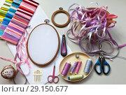 Купить «Accessories for embroidery with satin ribbons on a light table», фото № 29150677, снято 21 сентября 2018 г. (c) Виктория Катьянова / Фотобанк Лори
