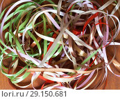 Купить «Set of colored satin ribbons for hand embroidery: green, pink, beige, brown and red on a wooden table», фото № 29150681, снято 27 сентября 2018 г. (c) Виктория Катьянова / Фотобанк Лори
