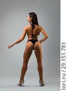Купить «Slim woman wearing black lingerie rearview», фото № 29151781, снято 19 сентября 2018 г. (c) Гурьянов Андрей / Фотобанк Лори