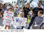 Купить «Florida, Miami Beach, Collins Park, March For Our Lives, public high school shootings gun violence protest, student, holding signs posters, boy, girl, mother, father, family,», фото № 29156813, снято 24 марта 2018 г. (c) age Fotostock / Фотобанк Лори