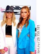 Tish Cyrus and Brandi Cyrus attending the 2017 Billboard Music Awards... Редакционное фото, фотограф DJDM / WENN.com / age Fotostock / Фотобанк Лори