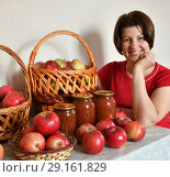 Купить «woman sitting at table with fresh apples and apple jam», фото № 29161829, снято 25 августа 2018 г. (c) Володина Ольга / Фотобанк Лори