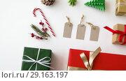 Купить «christmas gifts and decorations on white background», видеоролик № 29163197, снято 30 сентября 2018 г. (c) Syda Productions / Фотобанк Лори