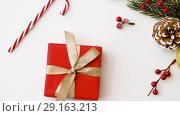Купить «christmas gift and decorations on white background», видеоролик № 29163213, снято 30 сентября 2018 г. (c) Syda Productions / Фотобанк Лори