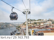 View of Oporto river and touristic walk area from aerial lift, Portugal. Стоковое фото, фотограф Carlos Dominique / age Fotostock / Фотобанк Лори