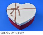 Купить «box for gifts in shape of heart on blue background», фото № 29164997, снято 23 сентября 2018 г. (c) Володина Ольга / Фотобанк Лори