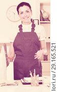 Купить «Cheerful female cleaning furniture in office», фото № 29165521, снято 2 июня 2017 г. (c) Яков Филимонов / Фотобанк Лори
