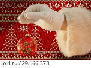 Купить «Composite image of santas hand is holding a christmas bulb », фото № 29166373, снято 24 февраля 2019 г. (c) Wavebreak Media / Фотобанк Лори