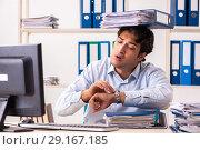 Купить «Overloaded busy employee with too much work and paperwork», фото № 29167185, снято 7 июля 2018 г. (c) Elnur / Фотобанк Лори