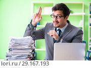 Купить «Employee chained to his desk due to workload», фото № 29167193, снято 11 мая 2018 г. (c) Elnur / Фотобанк Лори