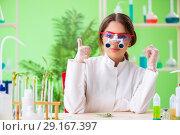 Beautiful female biotechnology scientist chemist working in lab. Стоковое фото, фотограф Elnur / Фотобанк Лори