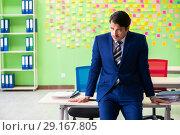 Купить «Businessman with many conflicting priorities», фото № 29167805, снято 23 мая 2018 г. (c) Elnur / Фотобанк Лори