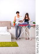Купить «Young woman doing ironing for her husband», фото № 29168009, снято 27 июня 2018 г. (c) Elnur / Фотобанк Лори