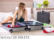 Купить «Young woman getting ready for summer vacation», фото № 29169513, снято 29 июня 2018 г. (c) Elnur / Фотобанк Лори