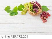 Купить «grape on wooden background», фото № 29172201, снято 28 сентября 2018 г. (c) Майя Крученкова / Фотобанк Лори