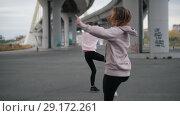 Купить «Young acrobatic girls doing ballet spins», видеоролик № 29172261, снято 15 октября 2019 г. (c) Константин Шишкин / Фотобанк Лори