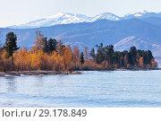 Купить «Lake Baikal on a sunny September day. View from the water on the snow-capped mountain range Khamar-Daban», фото № 29178849, снято 30 сентября 2018 г. (c) Виктория Катьянова / Фотобанк Лори