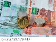 Купить «Российские монеты на фоне банкнот России достоинством 1000 и 5000 рублей», фото № 29179417, снято 12 апреля 2014 г. (c) александр афанасьев / Фотобанк Лори