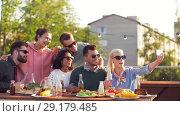 Купить «happy friends taking selfie at rooftop party», видеоролик № 29179485, снято 26 сентября 2018 г. (c) Syda Productions / Фотобанк Лори