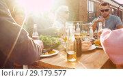 Купить «friends having dinner or bbq party on rooftop», видеоролик № 29179577, снято 26 сентября 2018 г. (c) Syda Productions / Фотобанк Лори