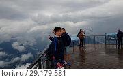 Купить «Sochi, Russia - June 2. 2018. Tourists at height of 2320 m in ski resort Rosa Khutor», видеоролик № 29179581, снято 27 сентября 2018 г. (c) Володина Ольга / Фотобанк Лори