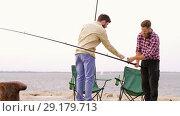 Купить «happy friends adjusting fishing rods on pier», видеоролик № 29179713, снято 28 сентября 2018 г. (c) Syda Productions / Фотобанк Лори