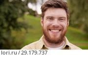 Купить «portrait of happy smiling man with red beard», видеоролик № 29179737, снято 28 сентября 2018 г. (c) Syda Productions / Фотобанк Лори