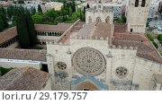 Купить «View from drone of ancient Benedictine abbey in Sant Cugat del Valles, Catalonia, Spain», видеоролик № 29179757, снято 11 июня 2018 г. (c) Яков Филимонов / Фотобанк Лори