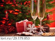 Купить «Champagne and gift. New year and Christmas.», фото № 29179853, снято 31 октября 2017 г. (c) Мельников Дмитрий / Фотобанк Лори