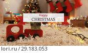 Купить «Happy Christmas text and Christmas decoration 4k», видеоролик № 29183053, снято 18 июля 2019 г. (c) Wavebreak Media / Фотобанк Лори