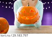 Купить «close up of woman with halloween pumpkin», фото № 29183797, снято 17 сентября 2014 г. (c) Syda Productions / Фотобанк Лори