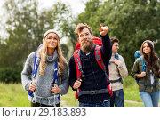 Купить «friends or travelers with backpacks hiking», фото № 29183893, снято 31 августа 2014 г. (c) Syda Productions / Фотобанк Лори