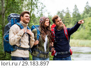 happy friends or travelers with backpacks hiking. Стоковое фото, фотограф Syda Productions / Фотобанк Лори