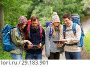 Купить «friends or travelers with backpacks and tablet pc», фото № 29183901, снято 31 августа 2014 г. (c) Syda Productions / Фотобанк Лори
