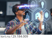 Купить «man in vr headset with virtual interface at office», фото № 29184009, снято 24 января 2018 г. (c) Syda Productions / Фотобанк Лори