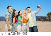 Купить «friends taking selfie on venice beach», фото № 29184085, снято 30 июня 2018 г. (c) Syda Productions / Фотобанк Лори