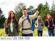 Купить «happy friends or travelers with backpacks hiking», фото № 29184109, снято 31 августа 2014 г. (c) Syda Productions / Фотобанк Лори