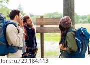 Купить «hiking friends with backpacks at signpost», фото № 29184113, снято 31 августа 2014 г. (c) Syda Productions / Фотобанк Лори