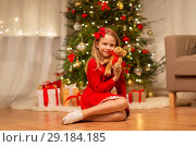 Купить «girl in red dress hugging teddy bear at home», фото № 29184185, снято 22 декабря 2017 г. (c) Syda Productions / Фотобанк Лори