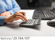 Купить «businesswoman with calculator at night office», фото № 29184197, снято 3 января 2018 г. (c) Syda Productions / Фотобанк Лори