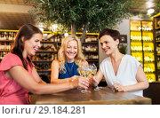 Купить «happy women drinking wine at bar or restaurant», фото № 29184281, снято 25 июня 2018 г. (c) Syda Productions / Фотобанк Лори