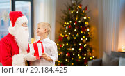 Купить «boy and santa with christmas gifts at home», фото № 29184425, снято 14 сентября 2014 г. (c) Syda Productions / Фотобанк Лори