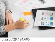Купить «web designer working on user interface at office», фото № 29184605, снято 17 января 2018 г. (c) Syda Productions / Фотобанк Лори