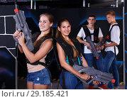 Купить «women with laser pistols», фото № 29185421, снято 27 августа 2018 г. (c) Яков Филимонов / Фотобанк Лори