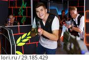 Купить «Smiling people in vests and with laser pistols playing emotionally laser tag game», фото № 29185429, снято 27 августа 2018 г. (c) Яков Филимонов / Фотобанк Лори