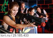 Купить «Portrait of exciting girl with laser pistol playing laser tag in dark room», фото № 29185433, снято 27 августа 2018 г. (c) Яков Филимонов / Фотобанк Лори