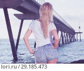 Купить «Cheerful female is posing on the rocks in her free time», фото № 29185473, снято 17 июля 2017 г. (c) Яков Филимонов / Фотобанк Лори