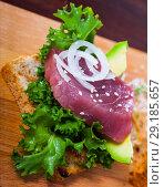 Купить «Toast with raw tuna and avocado», фото № 29185657, снято 18 октября 2018 г. (c) Яков Филимонов / Фотобанк Лори