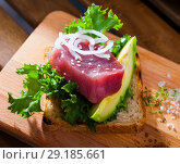 Купить «Toast with raw tuna and avocado», фото № 29185661, снято 19 октября 2018 г. (c) Яков Филимонов / Фотобанк Лори